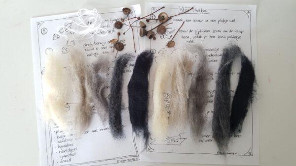 Verschillende plukken viltwol in grijstinten