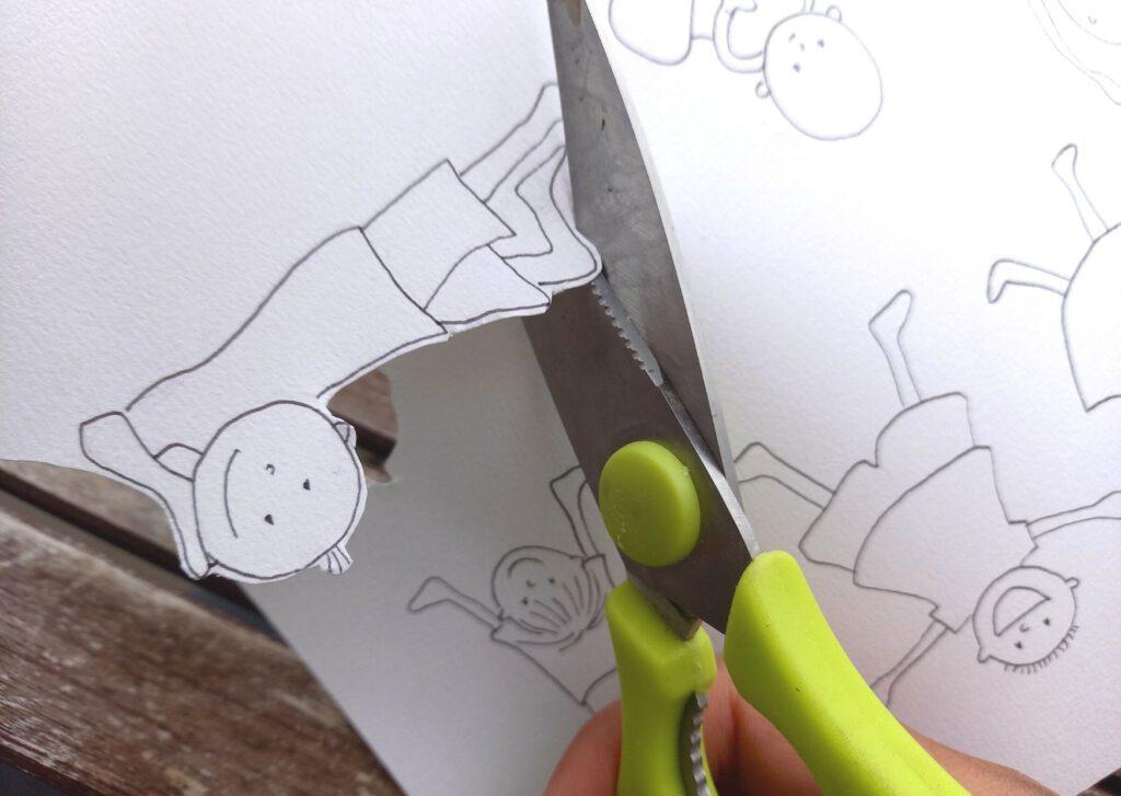 schaar knipt tekening uit